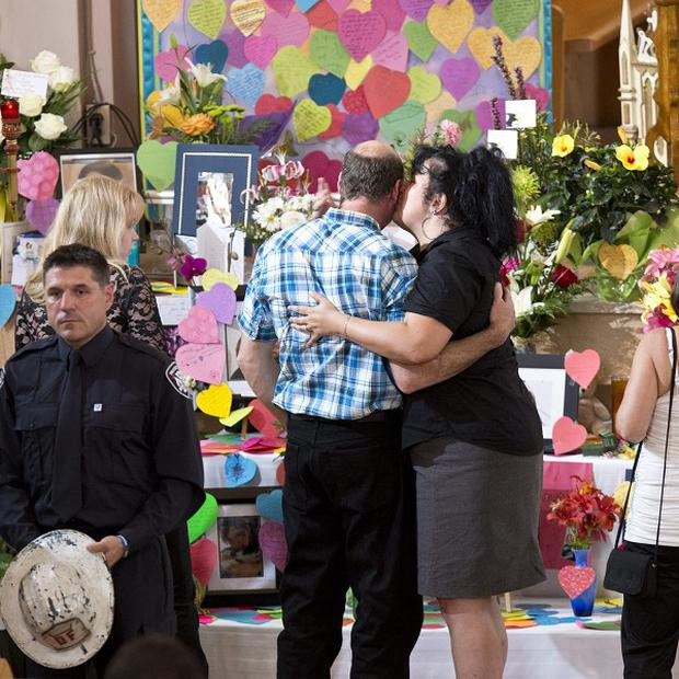 Mourners gather at a memorial service for the victims killed when a runaway oil train derailed and exploded in Lac-Megantic, Quebec (AP)