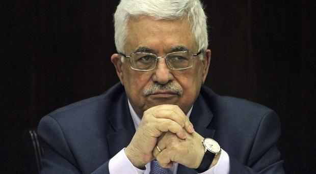 Palestinian President Mahmoud Abbas chairs a session of the Palestinian cabinet in the West Bank city of Ramallah (AP)
