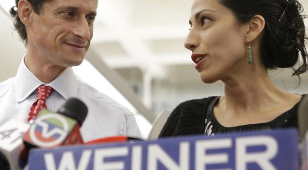 Anthony Weiner, pictured with wife Huma Abedin, said the manager of his campaign for the New York mayoralty has resigned