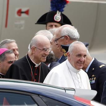 The pope arrives back at Rome's military airport (AP)