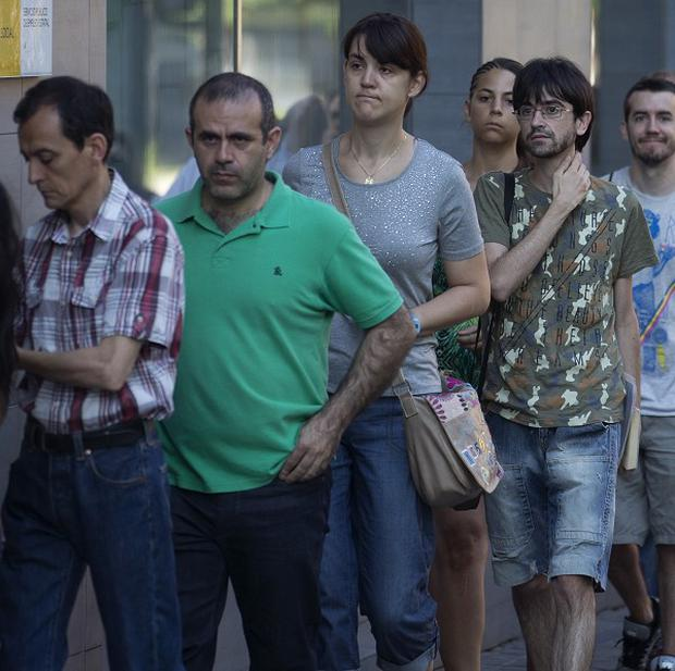 A queue at an unemployment registry office in Madrid. Earlier this week, Spain said the jobless rate fell, but the recession continues (AP)