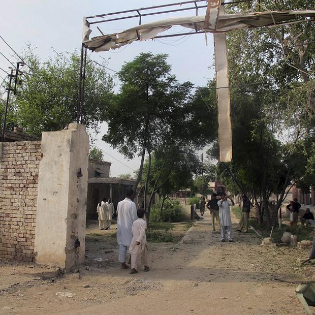 The main gate to the prison blown open by the Taliban (AP)