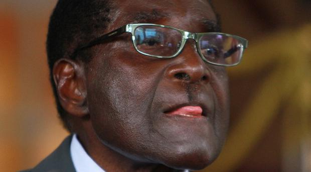 Zimbabwean president Robert Mugabe speaks during a press conference at State House in Harare (AP)
