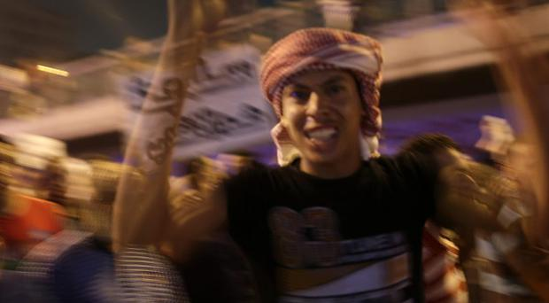 Supporters of former president Morsi take to the streets (AP)