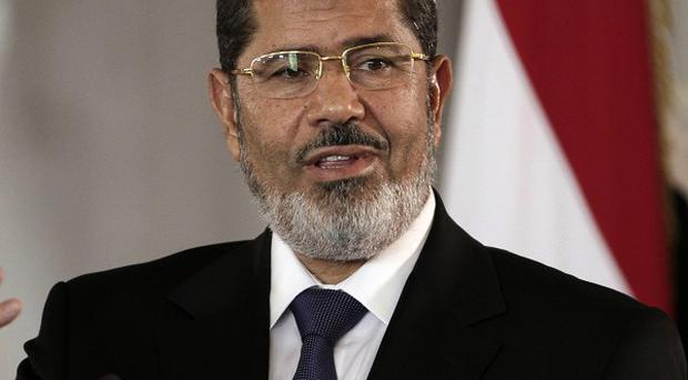 Former Egyptian president Mohammed Morsi has been held at various locations since he was ousted from power on July 3 (AP)