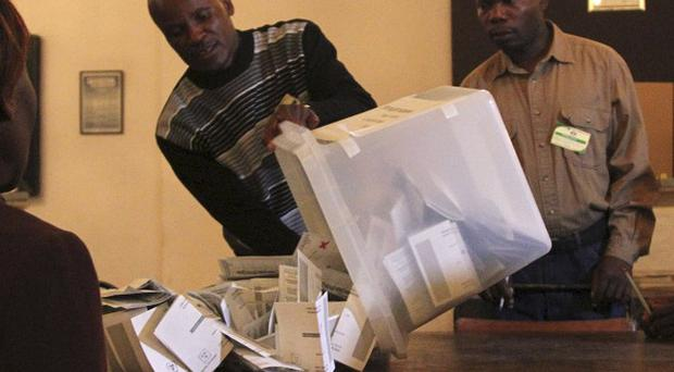 A ballot box is emptied in preparation to count votes in Zimbabwe's elections (AP)