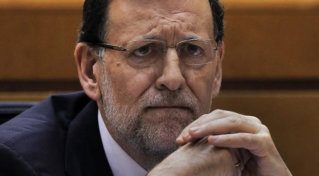Mariano Rajoy said he 'was wrong to maintain confidence in someone we now know did not deserve it' (AP)