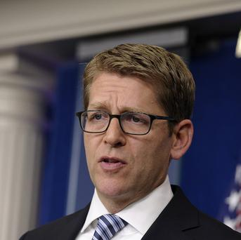White House Press Secretary Jay Carney said the US is 'extremely disappointed' at Russia granting asylum to Edward Snowden (AP)