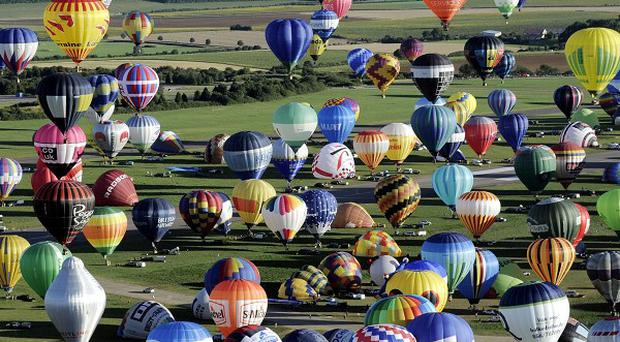 Over 400 hot-air balloons take off in Chambley-Bussieres, eastern France (AP)
