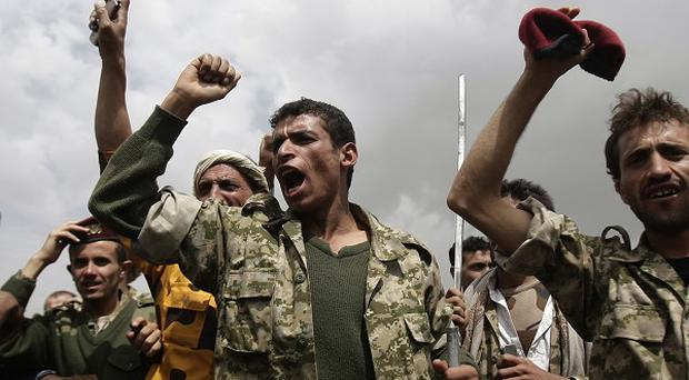 Yemeni republican guard troops, loyal to Yemen's ousted president Ali Abdullah Saleh, chant slogans (AP)