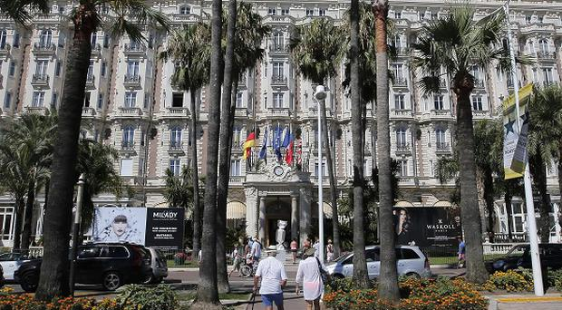 The Carlton Intercontinental Hotel in Cannes, scene of a daylight raid that netted more than £80m of jewels (AP)