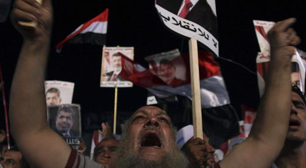 Supporters of Egypt's ousted president Mohammed Morsi in Cairo (AP)