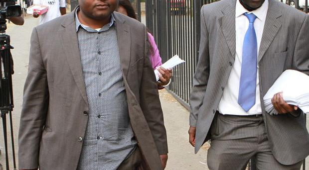 Chris Mhike, right, Morgan Tsvangirai's lawyer, arrives at the Constitutional Court (AP)