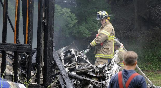 Firefighters work at the scene of a small plane crash in East Haven, Connecticut (AP)