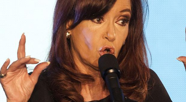 Argentine president Cristina Fernandez gives a speech regarding the election results in Buenos Aires, Argentina (AP)