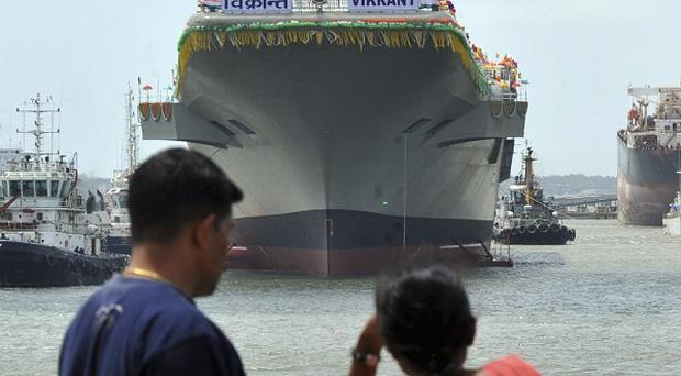 India's new aircraft carrier Vikrant anchored after its launch in Kochi (AP)