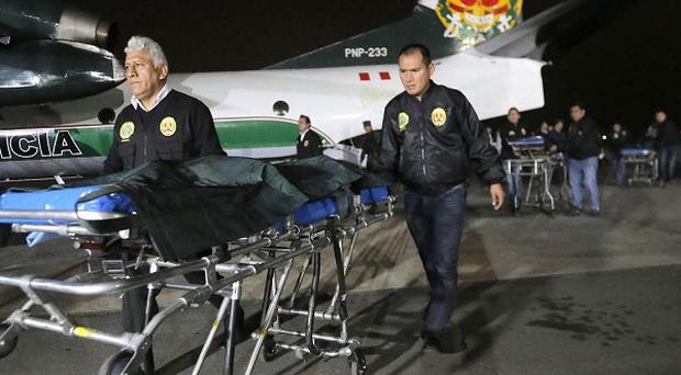 Peruvian police escort the bodies of two leaders of the Shining Path rebel group at police base in Lima (AP)