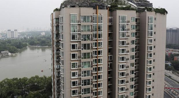 Beijing authorities are planning to demolish the bizarre villa on top of the apartment block's roof, in Haidian District (AP)