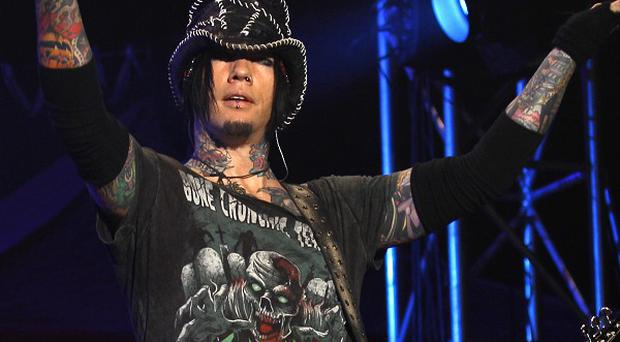 Guns N' Roses guitarist Ashba's free trip in a police helicopter is being investigated (AP)