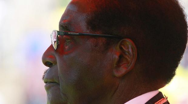Robert Mugabe says his election victory is a mandate for black empowerment (AP)