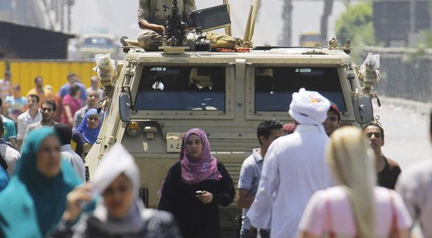 Egyptian troops keep watch over Morsi supporters (AP)