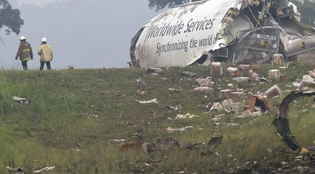 Wreckeage of the plane lies where it stopped (AP)