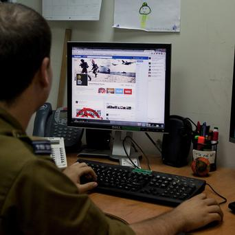 An Israeli soldier gets to grips with social media (AP)