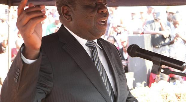 Morgan Tsvangirai is goi9ng to court to get full detials of the disputed election (AP)