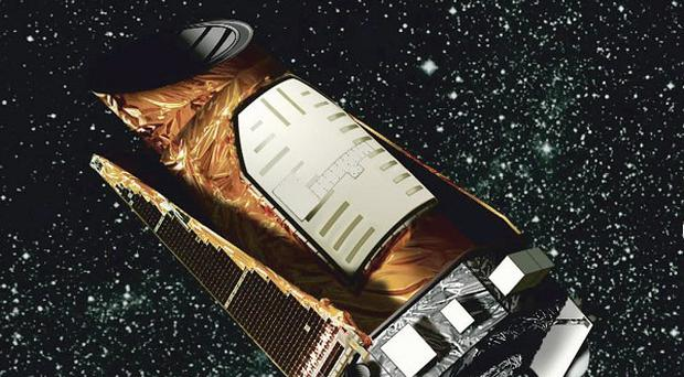 An artist's rendering shows the Kepler space telescope as Nasa calls off attempts to fix the crippled space telescope (AP/NASA)