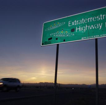 A car moves along the Extraterrestrial Highway along the border of Area 51 in Nevada (AP)