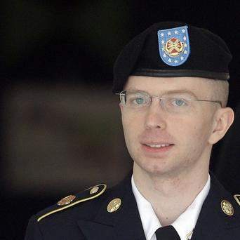 Bradley Manning is escorted to a security vehicle outside a courthouse in Fort Meade after a hearing in his court martial (AP)