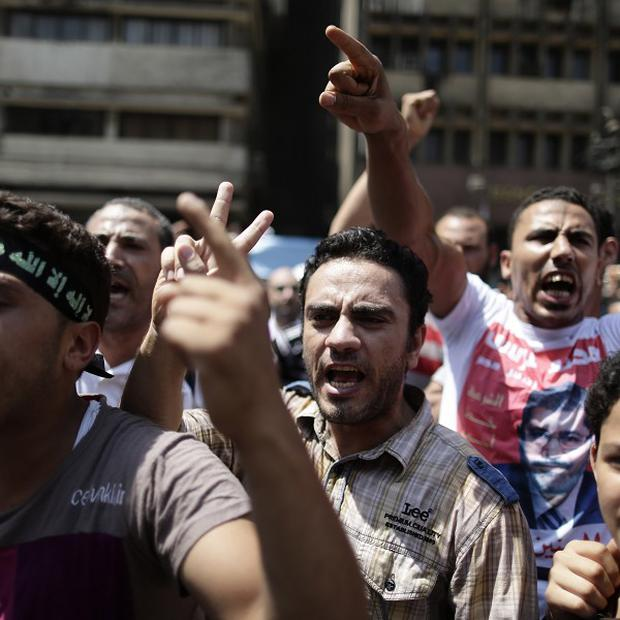 Supporters of Egypt's ousted President Mohammed Morsi chant slogans before clashes broke out with Egyptian security forces in Ramses Square (AP)