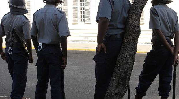 Zimbabwean police outside the Supreme Court in Harare (AP)