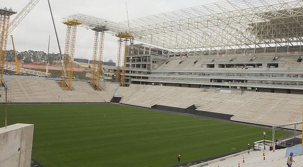 Construction work continues at a new stadium in Sao Paulo, Brazil, which will host the opening match of the World Cup in 2014 (AP)