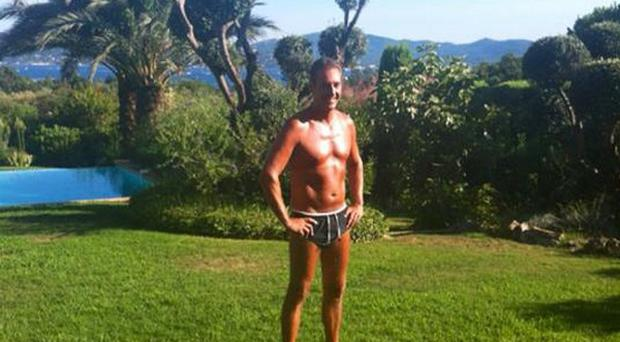Heinz-Christian Strache poses in his swimming trunkis (AP)