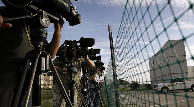 The press waits outside the court martial of Hasan (AP)