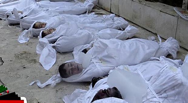 A picture taken by Syrian activists shows a line victims of what was claimed to be a poison gas attack (AP)