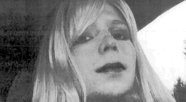 Bradley Manning poses for a photo wearing a wig and lipstick. He plans to live as a woman named Chelsea (AP/US Army)