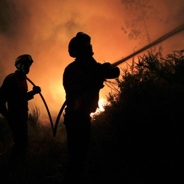 Portuguese firefighters tackle a blaze (AP)