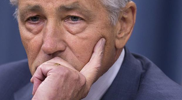 Chuck Hagel indicated that the US is moving naval forces closer to Syria (AP)
