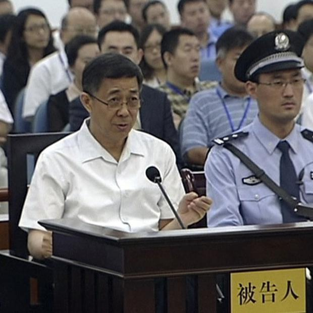 Former Chinese politician Bo Xilai, left, sits and speaks in a court room at Jinan Intermediate People's Court in China's Shandong province (AP)
