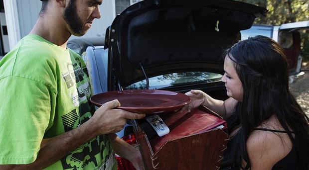 Residents pack up belongings as the fire threatens the small town of Tuolumne, California (AP)