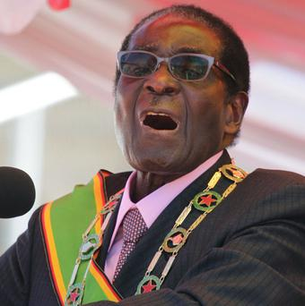 Robert Mugabe has threatened to expel foreign-owned companies from Zimbabwe (AP)