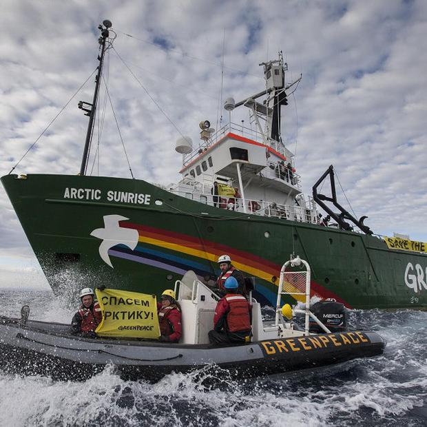 Russian coast guards have boarded a Greenpeace protest ship (AP)