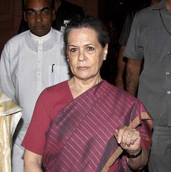 Sonia Gandhi leaves Indian Parliament House during the debate on National Food Security Bill 2013, in New Delhi (AP)
