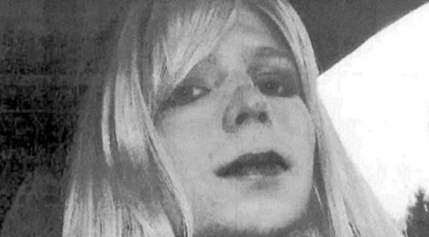 Private Chelsea Manning, who was previously known as Bradley Manning, poses for a photo wearing a wig and lipstick (AP/US Army)
