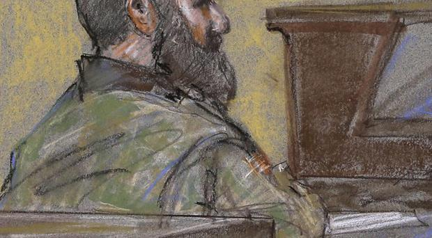 A courtroom sketch shows Maj Nidal Hasan as the guilty verdict is read at his court martial (AP/Brigitte Woosley)
