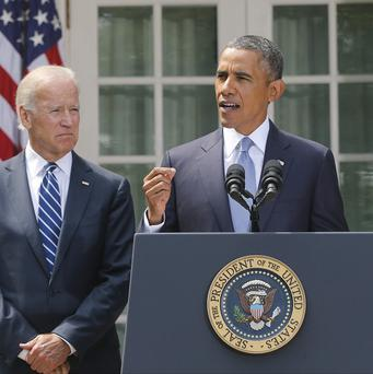 Barack Obama stands with Joe Biden as he makes a statement about Syria in the Rose Garden at the White House (AP)