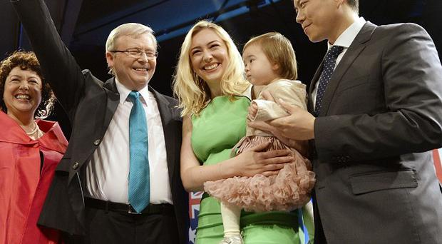 Australia's Prime Minister Kevin Rudd with his wife Therese Rein, daughter Jessica, son-in-law Albert Tse and granddaughter Josephine at a campaign rally (AP)