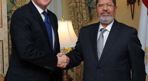 Prime Minister David Cameron with former Egyptian president Mohamed Morsi
